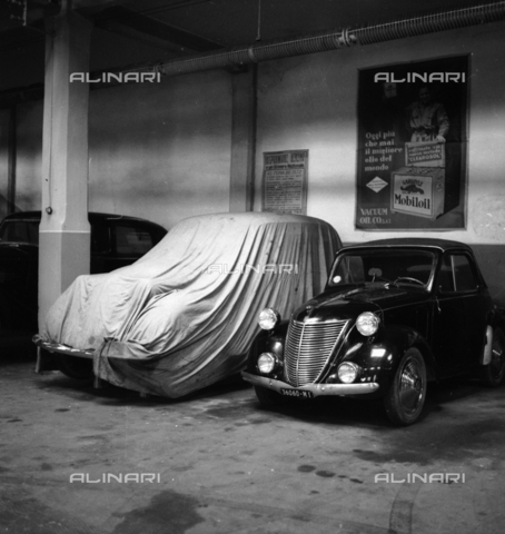 LAA-F-000261-0000 - Cars parked in a garage in Milan - Data dello scatto: 1940 - Archivi Alinari, Firenze