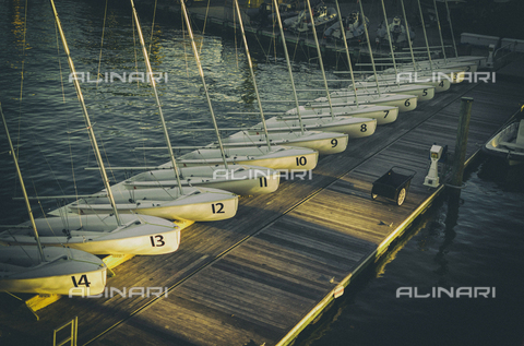 LCA-F-005073-0000 - Numbered sailing boats on a wooden jetty - Quint Lox / Liszt Collection/Alinari Archives