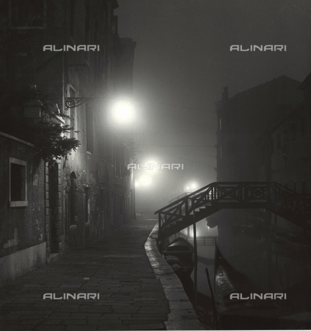 LFA-F-000006-0000 - View of a desert Venetian 'fondamenta' wrapped in a foggy night. On the right a small, private, wooden bridge built on the Rio Ognissanti