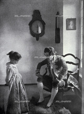 LOB-S-000924-0001 - In a 18th century setting a gentleman in elegant embroidered tail coat and wig scolding a small girl. She looks sad and ashamed and is looking down, frightened by the young man's severe look - Data dello scatto: 1923-1924 - Archivi Alinari, Firenze