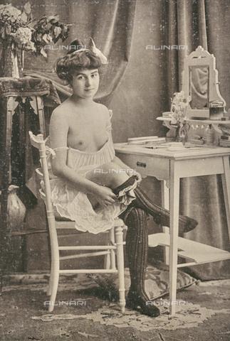 """LVQ-L-000214-0004 - Woman with breasts uncovered wearing a sock, photography taken from the dossier """"Le Deshabillé documentaire. Etude artistique Illustrée de Cent compositions photographiques d'après Nature"""", 1 Fascicule, J. B. de la Hoà¼e, Nouvelle Librairie Artistique 7-9 Rue de la Boà«tie, Paris - Date of photography: 1900-1910 ca. - Fratelli Alinari Museum Collections, Florence"""