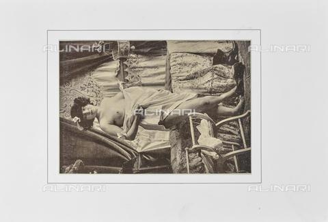 """LVQ-L-000215-P025 - Woman in undergarment with breast exposed, photography taken from the dossier """"Le Deshabillé documentaire. Etude artistique Illustrée de Cent compositions photographiques d'après Nature"""", 2 Fascicule, J. B. de la Hoà¼e, Nouvelle Librairie Artistique 7-9 Rue de la Boà«tie, Paris - Date of photography: 1900-1910 ca. - Fratelli Alinari Museum Collections, Florence"""