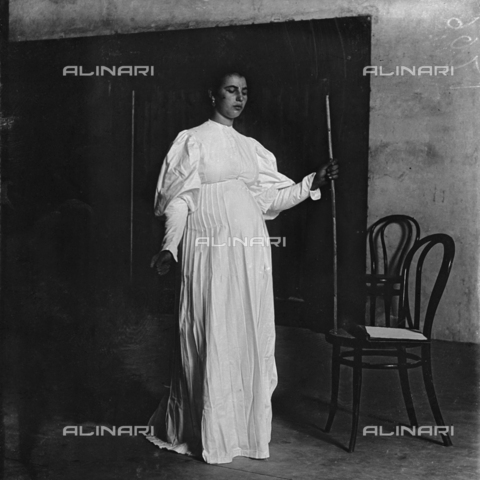 MFA-S-0SN406-000D - Portrait of a woman posing in traditional costumes holding a stick in her hand - Date of photography: 1900 ca. - Alinari Archives-Michetti Archive, Florence