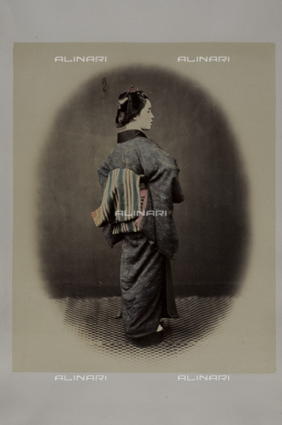 MFC-A-004626-0008 - Full-length portrait of a young japanese lady. She is seen from the back, her face in profile. She wears a kimono, the traditional japanese dress, and her hairdress is decorated with laquered sticks (kanzashi) - Data dello scatto: 1863-1868 ca. - Archivi Alinari, Firenze