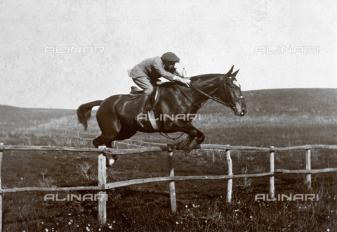 MFC-A-004638-0015 - Portrait of a man on horseback jumping a fence in the roman countryside