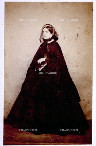 MFC-F-000368-0000 - Portrait of woman with veil, cape and book in hand - Date of photography: 1855 -1865 - Fratelli Alinari Museum Collections-Malandrini Collection, Florence