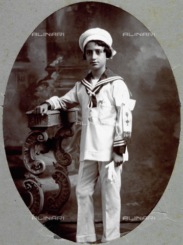 MFC-F-001711-0000 - Portrait of a little boy on his confirmation. He is wearing a sailor boy outfit and has the sash of the sacrament on his arm - Date of photography: 1920 ca. - Fratelli Alinari Museum Collections-Malandrini Collection, Florence