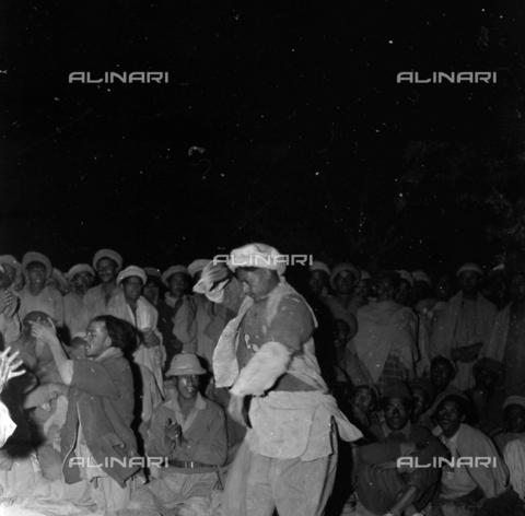 MFV-S-CAI021-0538 - CAI expedition to Gasherbrum IV in the Karakorum massif: bearers dance and sing around the fire - Date of photography: 30/04/1958-03/09/1958 - Fosco Maraini/Gabinetto Vieusseux Property©Fratelli Alinari