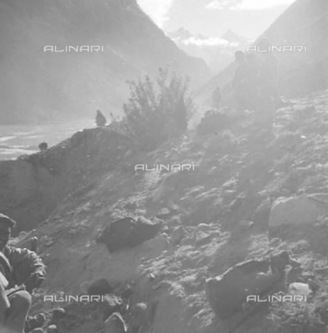 MFV-S-CAI021-0547 - CAI expedition to Gasherbrum IV in the Karakorum massif: bearers among the rocks - Date of photography: 30/04/1958-03/09/1958 - Fosco Maraini/Gabinetto Vieusseux Property©Fratelli Alinari