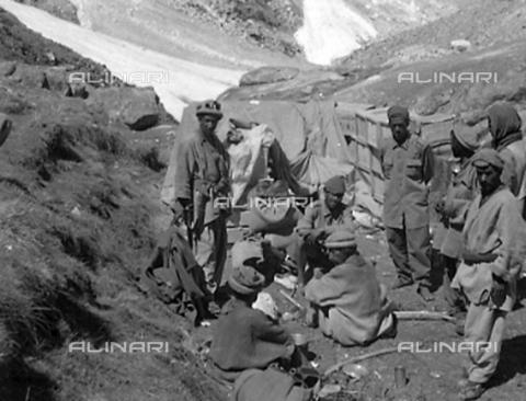MFV-S-CAI021-0564 - CAI expedition to Gasherbrum IV in the Karakorum massif: bearers among the rocks - Date of photography: 30/04/1958-03/09/1958 - Fosco Maraini/Gabinetto Vieusseux Property©Fratelli Alinari