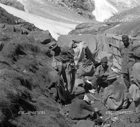 MFV-S-CAI021-0565 - CAI expedition to Gasherbrum IV in the Karakorum massif: bearers among the rocks - Date of photography: 30/04/1958-03/09/1958 - Fosco Maraini/Gabinetto Vieusseux Property©Fratelli Alinari