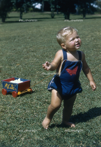 NVQ-S-000520-0075 - Little boy with a toy wagon; America
