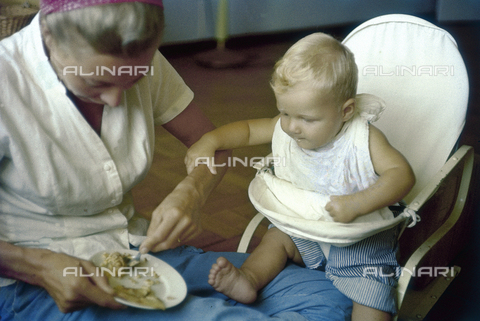 NVQ-S-000520-0088 - Baby taking food from his mother; America
