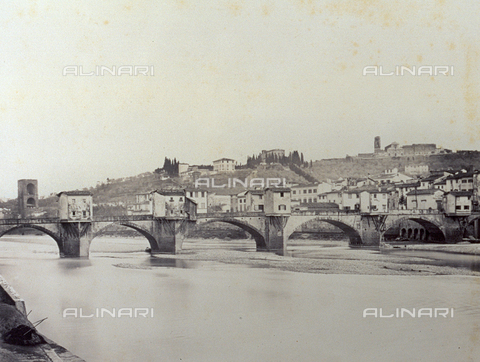 PDC-F-000309-0000 - The 'Ponte alle Grazie'. Over a dry Arno, with large weirs. In the background the town and hills of San Miniato - Date of photography: 1855-1865 - Alinari Archives-Palazzoli Collection, Florence