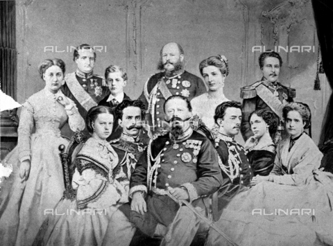 PDC-F-001414-0000 - Photomontage of a family group of the house of Savoy. From the left, Maria Vittoria, Girolamo Napoleone, prince Tommaso, prince Eugenio di Carignano, Margherita and Luigi, king of Portugal and husband of Maria Pia of Savoy, seated, Maria Pia daughter of Victor Emmanuel, Amedeo Ferdinando Maria of Savoia (king of Spain), king Victor Emmanuel, his son Umberto, Elisabeth of Saxony and Clotilde - Data dello scatto: 1867 -1877 ca. - Archivi Alinari, Firenze