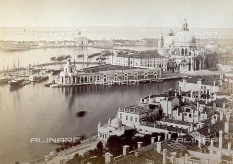 PDC-F-001735-0000 - Panorama of Venice from the bell tower of San Marco towards Santa Maria della Salute. At the entrance to the Grand Canal the low customs building (Dogana di Mare) can be made out, with on the right the Seminario Patriarcale (now housing the Manfrediniana picture gallery), the church of Santa Maria della Salute, the apse of San Gregorio. In the background, the church of the Redentore on the Giudecca. - Data dello scatto: 1870 ca. - Archivi Alinari, Firenze