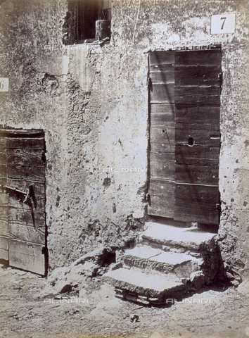 PDC-S-003217-0008 - Detail of a rural stone house. In the foreground the half-closed door, identified by the number on the door - Data dello scatto: 1872 ca. - Archivi Alinari, Firenze