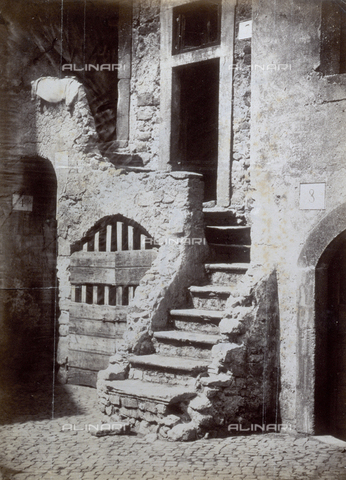 PDC-S-003217-0011 - Detail of a rural stone house. In the foreground the steps that lead to the front door. To the left a wooden door with latch - Data dello scatto: 1872 ca. - Archivi Alinari, Firenze