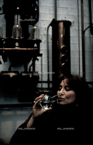 RCS-S-E20350-0001 - Giannola Nonino tastes a glass of grappa, in her family's distillery in Percoto, near Udine - Data dello scatto: 1987 - RCS/Alinari Archives Management, Florence