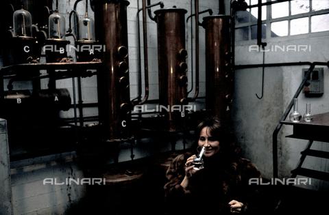 RCS-S-E20350-0009 - Giannola Nonino tastes a glass of grappa, in her family's distillery in Percoto, near Udine - Data dello scatto: 1987 - RCS/Alinari Archives Management, Florence
