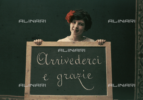 "RGD-F-001805-0000 - Little girl shows a chalkboard with the words ""Goodbye and Thanks"""