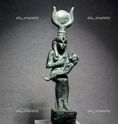 SEA-S-M21984-0006 - Iside nursing Horo, bronze, Egypt from the XXV dynasty (775-653 b.c) Milan, Collection of Egyptian Civilization at the Museum of Castello Sforzesco - Date of photography: 1984 - Seat Archive/Alinari Archives