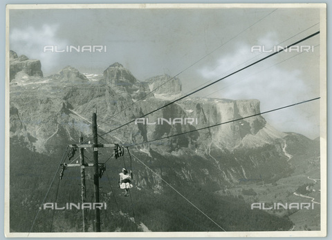 TCI-S-012094-AR03 - South Tyrol, corvara, Val Badia, riding group, hiker on the chairlift, 1954 - Touring Club Italiano/Alinari Archives Management