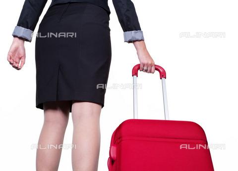 ULL-S-100385-0654 - Business woman with a red trolley - Data dello scatto: 25/07/2012 - Wodicka / Ullstein Bild / Alinari Archives