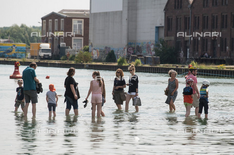 """ULL-S-101461-4720 - Some people walk on the installation """"Auf dem wasser"""" (On water) by Ayse Erkmen (1949-), located at the Münster International Exhibition - Sven Simon / Ullstein Bild / Alinari Archives"""