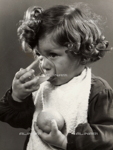 VAA-F-000221-0000 - Photo of a little girl drinking orange juice