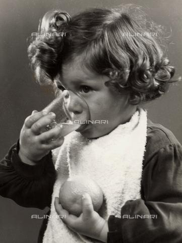 VAA-F-000221-0000 - Photo of a little girl drinking orange juice
