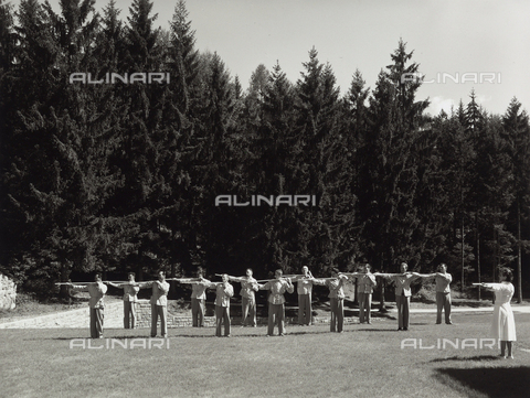VBA-S-003724-0237 - INAIL, Convalescent home of Pergine: an instructor leading the patients during an outdoor gymnastics lesson