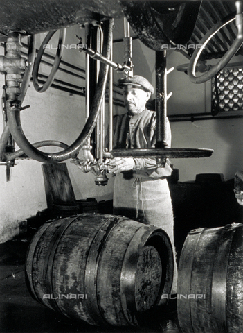 VBA-S-004347-0049 - A worker in front of some isobarometric equipment inside a brewery
