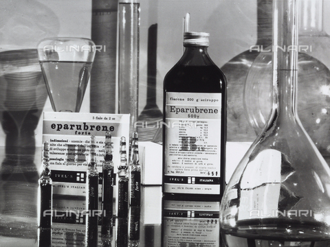 "VBA-S-004633-0130 - The medicine ""Eparabrene"" in vials and bottles of syrup with some laboratory test tubes."