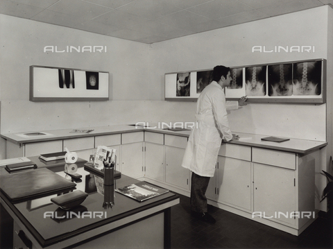 VBA-S-006520-0205 - Center of Laboratory Analysis at Chianciano Spa. Radiology room with a young doctor analyzing a screen with some x-rays.
