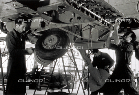 VBA-S-012200-0110 - Technicians building an airplane in a hangar Caproni