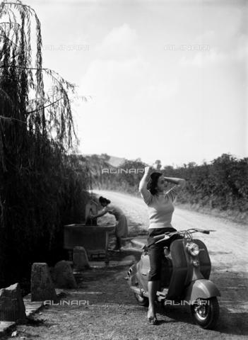 VBA-S-A07090-0002 - Cartellone pubblicitario dello scooter Lambretta Innocenti - Data dello scatto: 1960 ca. - Archivi Alinari, Firenze