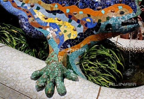 WHA-S-WHA041-0539 - Mosaic lizard at Antoni Gaudi's Parc Guell, Barcelona, Spain. Park Güell is a garden complex with architectural elements situated on the hill of El Carmel in the Gràcia district of Barcelona, Catalonia, Spain. It was designed by the Catalan architect Antoni Gaudi and built in the years 1900 to 1914. It is part of the UNESCO World Heritage Site 'Works of Antoni Gaudi. - World History Archive/Archivi Alinari