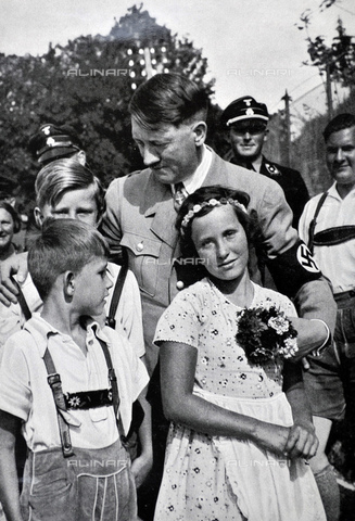 WHA-S-WHA041-0747 - Adolf Hitler 1889-1945. German politician and the leader of the Nazi Party, greeted by Hitler Youth as Baldur von Schirach looks on - World History Archive/Archivi Alinari