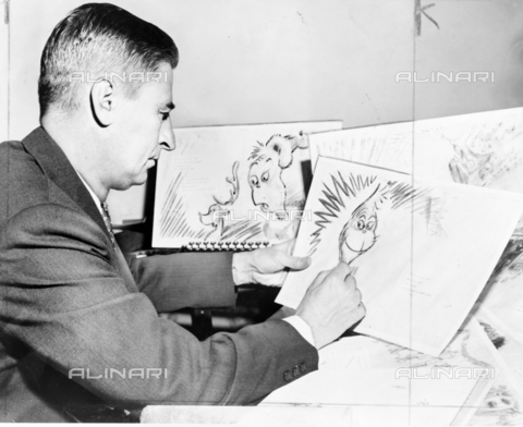 WHA-S-WHA041-0781 - Theodor Seuss Geisel 1904  1991, American writer, poet, and cartoonist at work on a drawing of a grinch, the hero of his forthcoming book, 'How the Grinch Stole Christmas' - World History Archive/Archivi Alinari