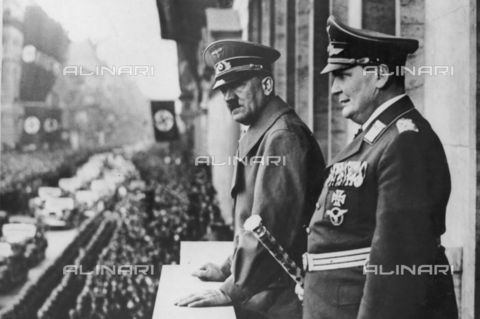 WHA-S-WHA041-0784 - Hermann Goring and Adolf Hitler review a parade in Prussia 1938 - World History Archive/Alinari Archives