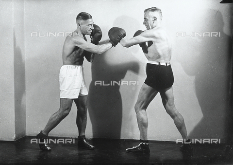 WMA-F-006863-0000 - Two boxers. The man in black shorts is De Mejo