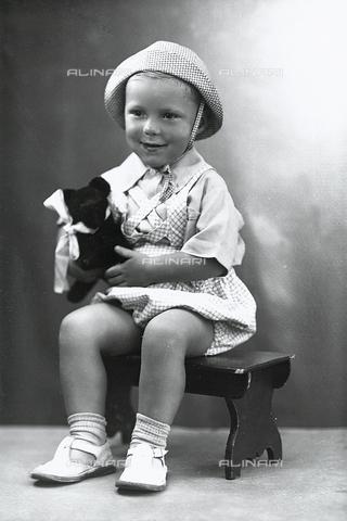 WWA-F-005846-0000 - Portrait of a baby with a stuffed dog