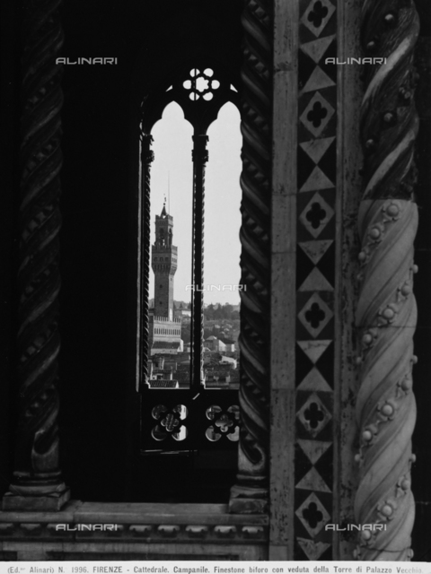 Mullioned window with a view of the Tower of Palazzo Vecchio in Florence