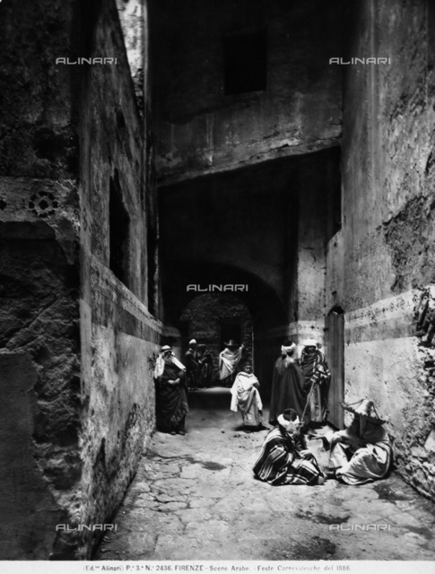 Carnival festivities in Arab costume, held in the old Jewish ghetto of Florence, in 1886: men in costume in an alley