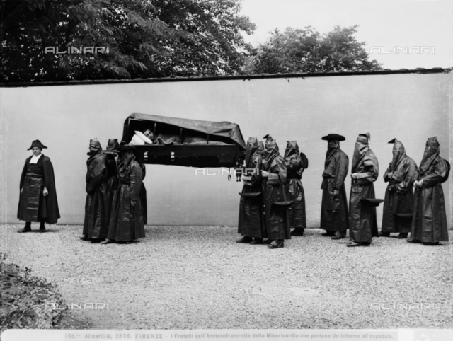 Florence. Brothers of the Venerable Confraternity of the Misericordia transporting a sick person
