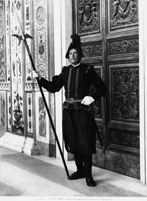 Swiss Guard in front of a door to the Palazzi Vaticani