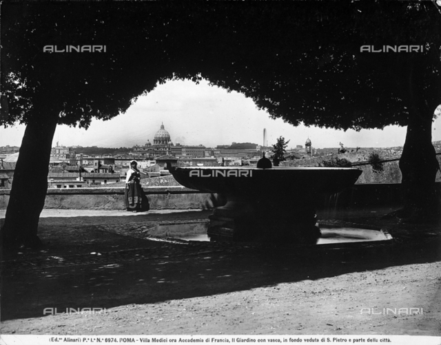 View of Rome from Villa Medici. A woman is posing by a fountain in the foreground.