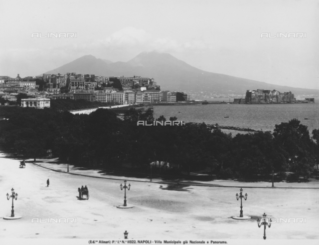 Panoramic view of Naples from Via Caracciolo, flanked by the park of the Villa Comunale (formerly Villa Nazionale). Mount Vesuvius can be seen in the background