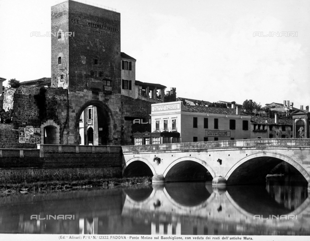 View of Molino Bridge over Bacchiglione with the remains of the ancient walls in Padua.